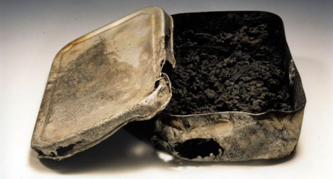 Lunch box image - Shigeru Orimen was a first-year student at Second Hiroshima Prefectural Junior High School. A few days after the bombing, his mother found Orimen's body with this lunch box clutched under his stomach. The bomb had turned his lunch into nothing but charred remains.